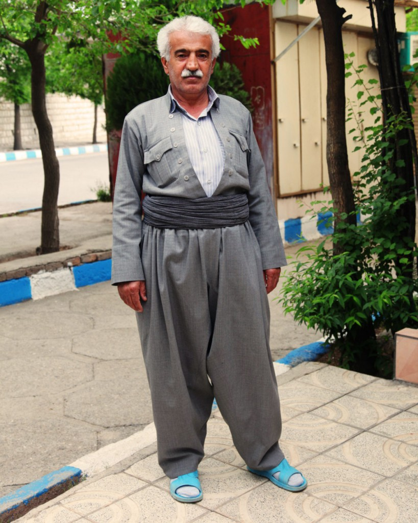 Kurdish traditional costume with rubber sandals: in the country's