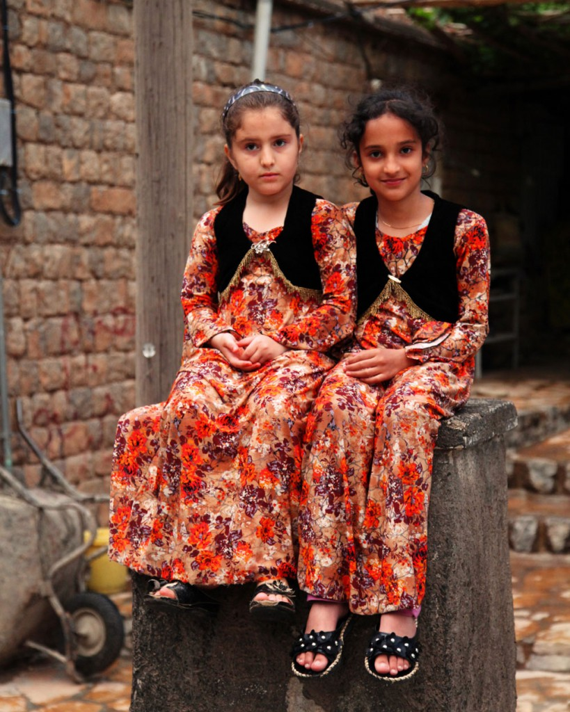 Girls in Hajij in western Iran: one day, the little mountain village might become a popular tourist destination. However, it lies close to the border to Iraq, where currently, one has to get precise information about how safe it is to travel there.