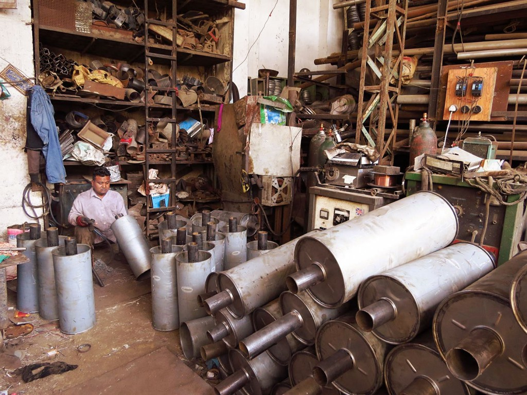 All kinds of metalworks are piled up in dark halls with high ceilings.