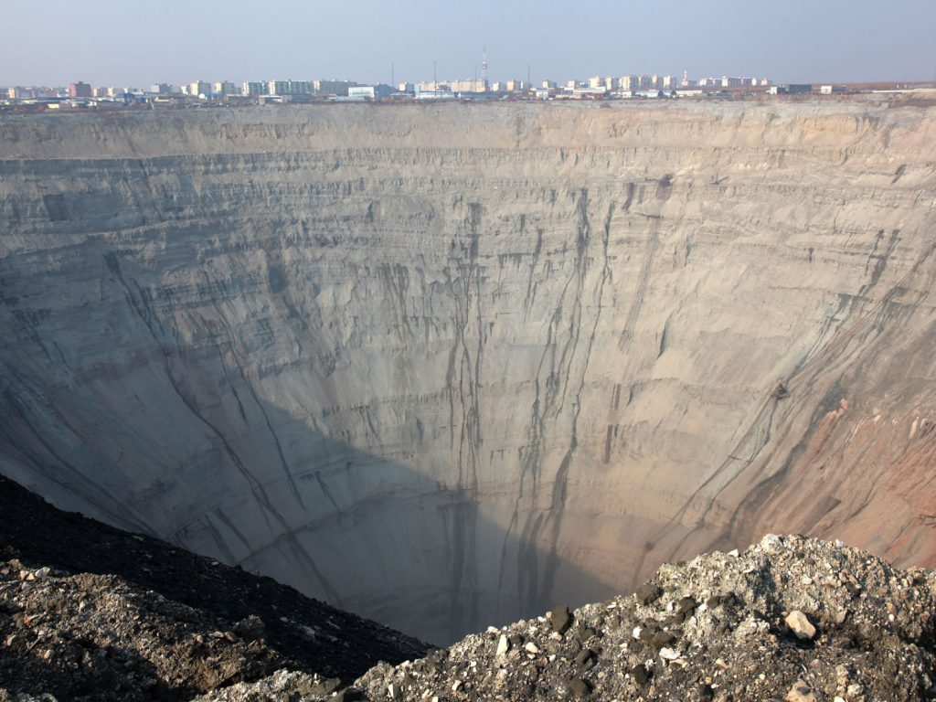 In the background are houses: in Mirny, in deepest Siberia, people live right next to an enormous crater.