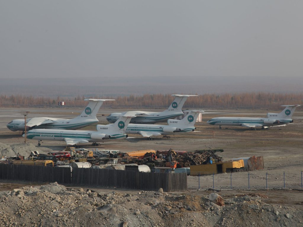 At Mirny Airport, decommissioned Tupolev planes are lying around.