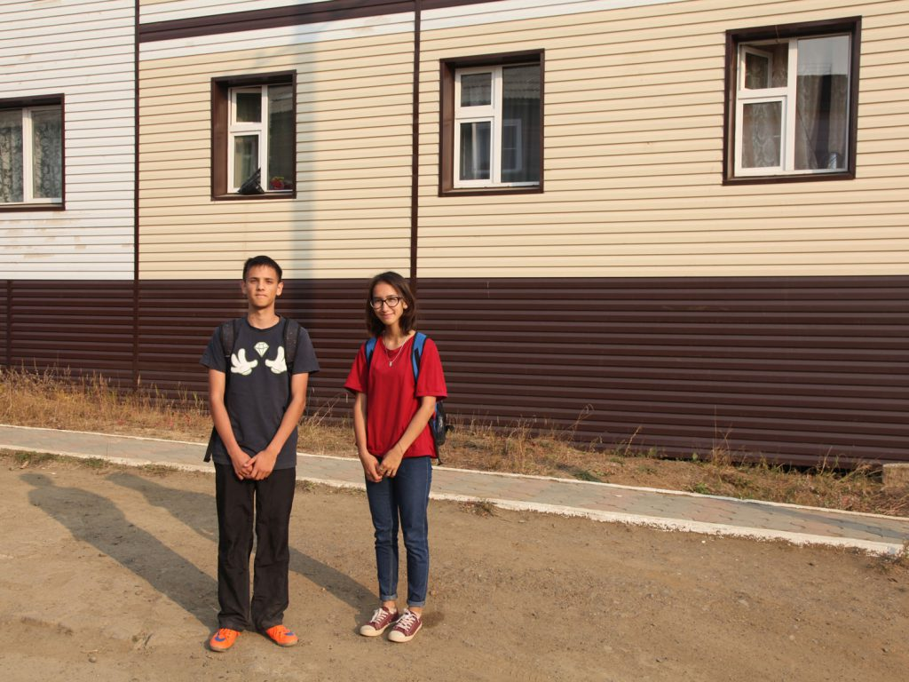 Olga and Sergei, two schoolchildren: both are very pleased to meet a foreigner, so they can practise their English.